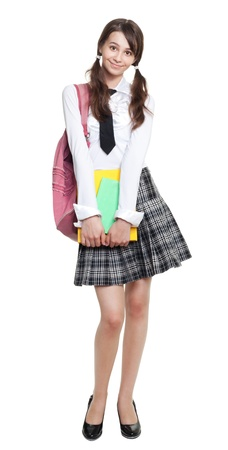 Shy teen girl with books and backpack and school formal clothes