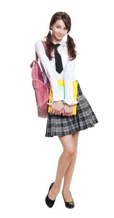 colegiala: Hermosa colegiala adolescente con libros y longitud completa de la mochila Foto de archivo