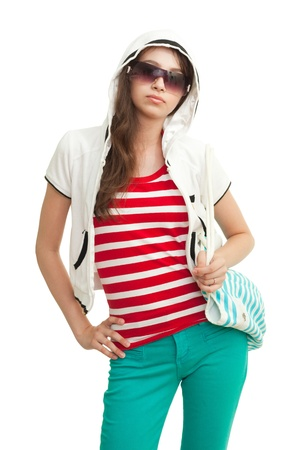 Stylish teenage girl wearing shades, hood and looking at camera Stock Photo