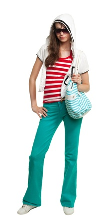Stylish teenage girl wearing shades and holding purse isolated on white Stock Photo - 8375136