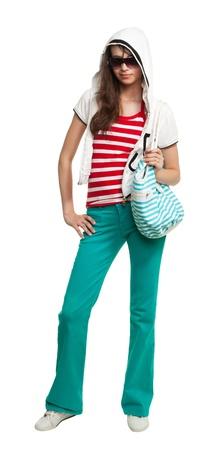 supercilious: Stylish teenage girl wearing shades and holding purse isolated on white
