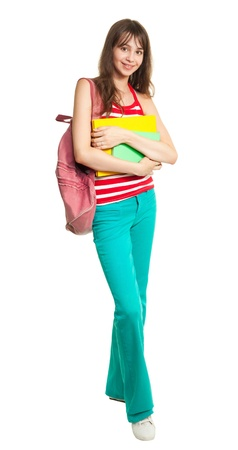supercilious: Schoolgirl with books and backpack standing isolated on white