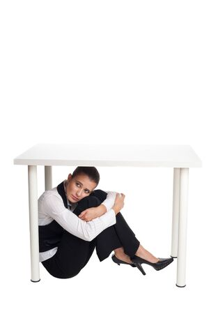 Sad office woman sit and hide under the table and crying photo