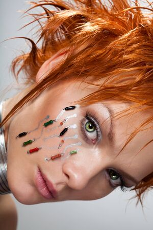 Face of a beautiful cybrer woman with transistors on visible on her face Stock Photo - 8434009