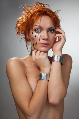 Futuristic woman feel shy with chips in her face and metal garments Stock Photo - 8433909