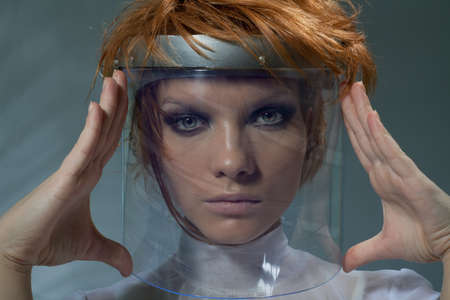 Serious clever woman in glass mask staring at camera photo
