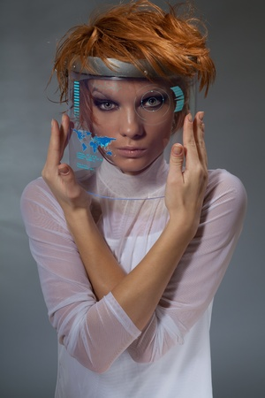 Beautiful woman with navigation display embedded in her mask photo