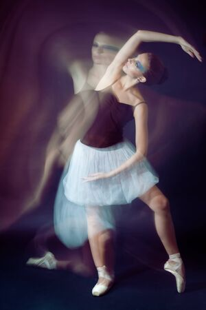 action blur: ballet dancer motion shoot made by both impulse and continues lights Stock Photo