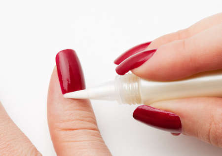 moisturizing skin around nails (cuticle) in nail service photo