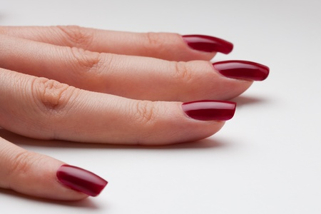 Just from fingernail service - newly painted nails with red enamel photo