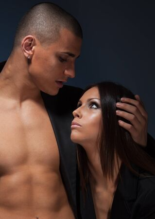 Portrait of couple looking on each other with athletic body man and beautiful girl photo