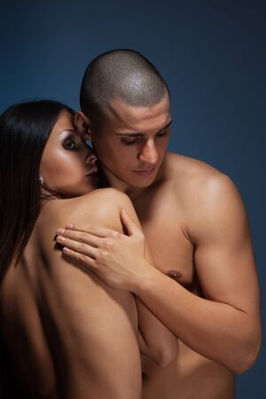 Naked couple with man snuggle up girlfriend on dark background Stock Photo - 9101066
