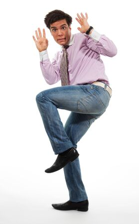 horrified: terrified man surrender wearing jeans, shirt and tie, isolated on white Stock Photo