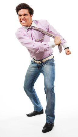 Angry man tear his tie man wearing jeans, shirt and tie, isolated on white Stock Photo - 9097034