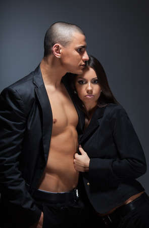 Beautiful couple standing with muscular boyfriend snuggle up beautiful girlfriend to his shoulder photo