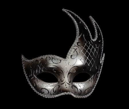 Silver classic carnaval venetian mask isolated on black photo