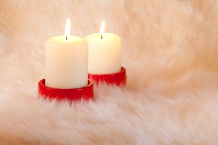 Couple candles on white home like fur background Stock Photo - 9097144