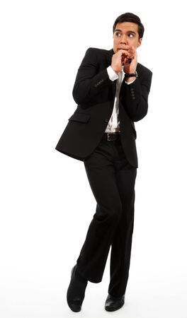 Afraid businessman showing frightening gesture and looking aside Stock Photo