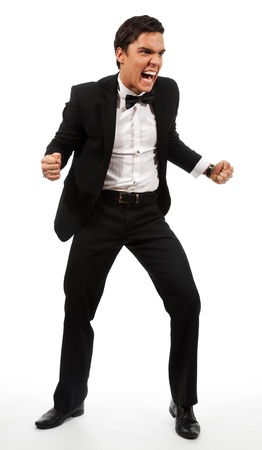 extremely: Extremely angry businessman part his hands with fists and roaring wearing a suit