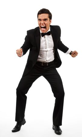 furious adult yelling and holding his fists ready to fight, sanding and wearing formal clothes Stock Photo - 9096923