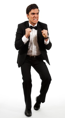 Disappointed investor in rage holding his fists, isolated on white Stock Photo - 9096932