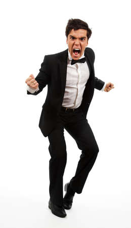 gesticulating: Frustrated business man with wide open mouth and gesticulating with hands and fists, isolated on white