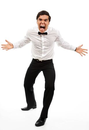 infuriate: Missed deadline - roaring manager stand with wide parted hands in aggressive pose