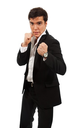 Fierce business - a man standing with fists and ready to fight photo