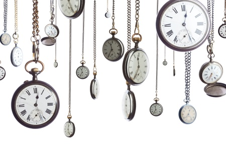 A number of pocket watches on chain isolated on white photo