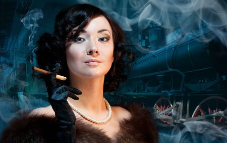 Traveling by train at last century - smoking woman waiting for a train and smokning photo