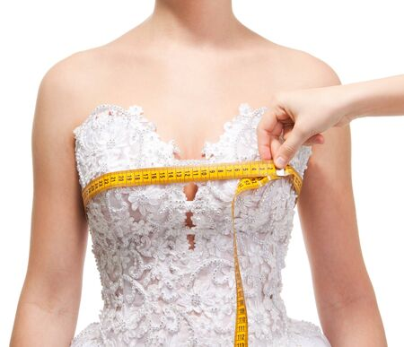 Measuring the the grasp of breast with centimeter, isolated on white Stock Photo - 9097075