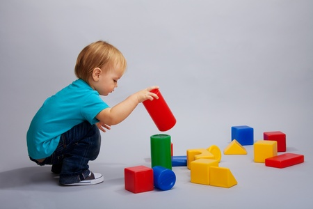 Kid playing colorful with plastic blocks photo