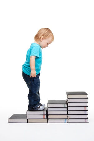 First steps of education - kid on steps made of books Stock Photo - 9096860