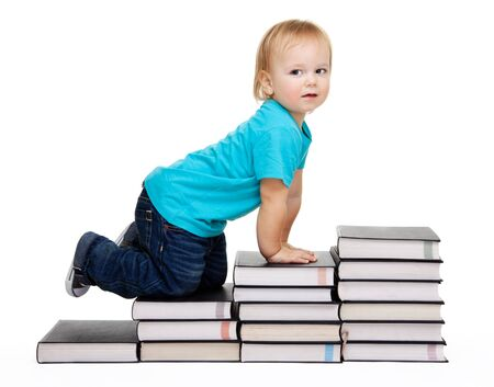 A toddler crawl for education represented by a conception steps made of books photo