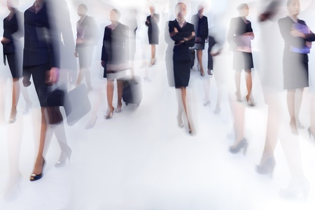 A number of business people walking - blurred motion photo