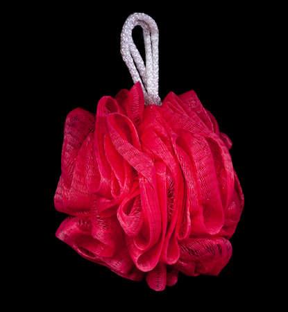 Pink bath sponge isolated on dark black background Stock Photo - 9486717