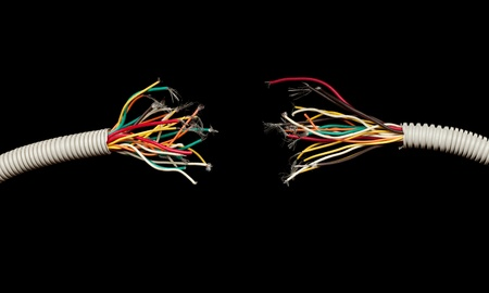 disconnected: torn apart wires isolated on black background Stock Photo