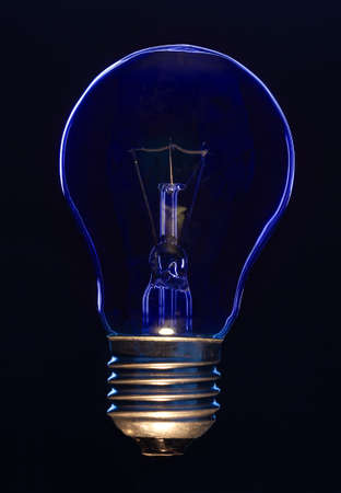 Light bulb on black background lit with blue light Stock Photo - 9486551