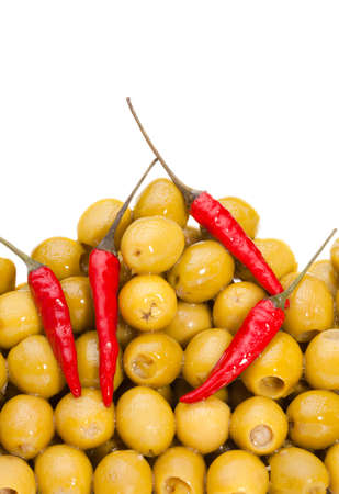 Pile of  olives with chili pepper isolated on white Stock Photo - 9486863