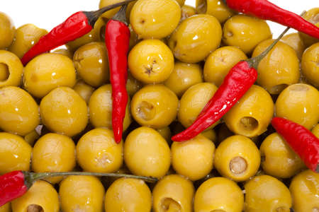 Big pile of  olives with red chili pepper isolated on white Stock Photo - 9487020