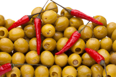 Pile of olives with red chili pepper isolated on white Stock Photo - 9486944