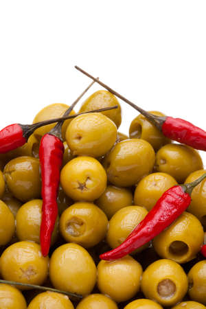 Many olives and pepper close-up on white background Stock Photo - 9486882