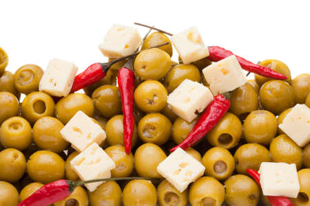 Pile of olives and chili pepper and sheep cheese on white background Stock Photo - 9486313