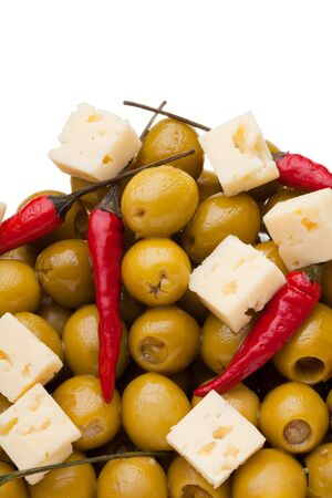 Close-up of a pile of olives and chili pepper and shards of sheep cheese on white background Stock Photo - 9486880