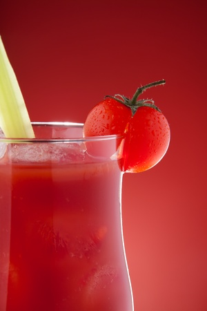 Close-up of glass with bloody Mary on red background photo