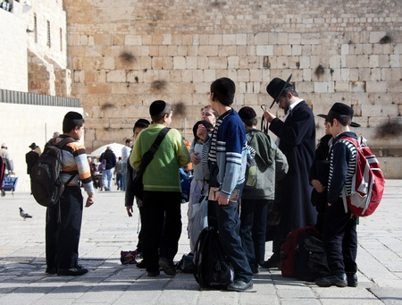 Jerusalem, Old city, Jewish quarter, Israel, January 05, 2011: Group of Jewish pilgrim children people with Western Wall on background