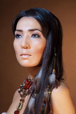 indian brave: Close-up portrait of American Indian girl with professional makeup