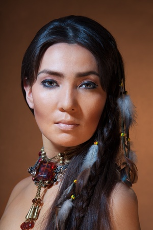 indian brave: Studio portrait of American Indian woman with professional makeup Stock Photo