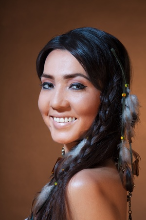 indian brave: Studio portrait of Smiling American Indian woman with professional makeup Stock Photo