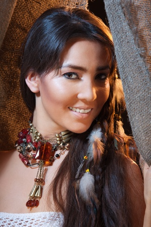 Smiling American Indian female - studio photo with professional makeup photo